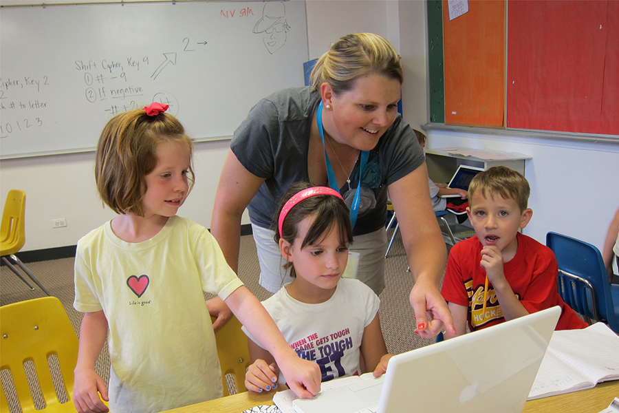 Teacher with Young Students in Classroom