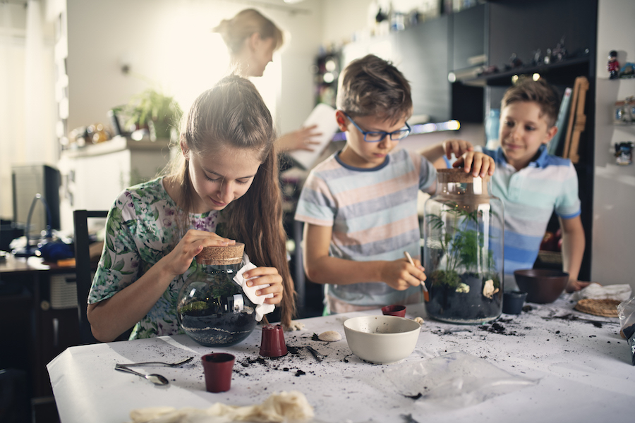 children conducting experiment in kitchen