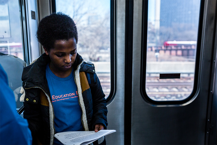 high school student on Chicago elevated train
