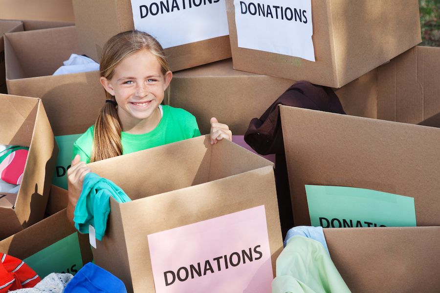 young girl sorting donations