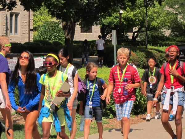 group of middle school students on campus